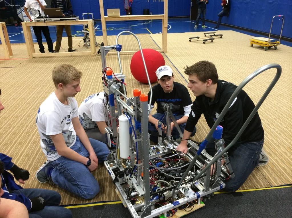 Matthew+Hoekzema%2C+freshman%2C+Brennan+Murphy%2C+sophomore%2C+and+Alex+Kessel%2C+junior%2C+work+on+this+year%27s+robot.