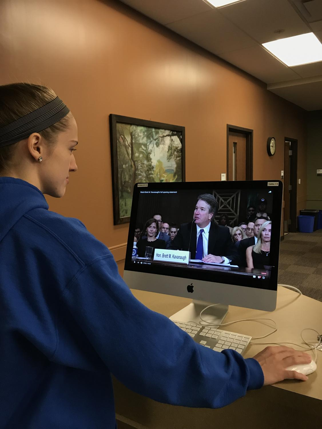 Junior, Allison Hardin, watches the Kavanaugh hearings on YouTube.