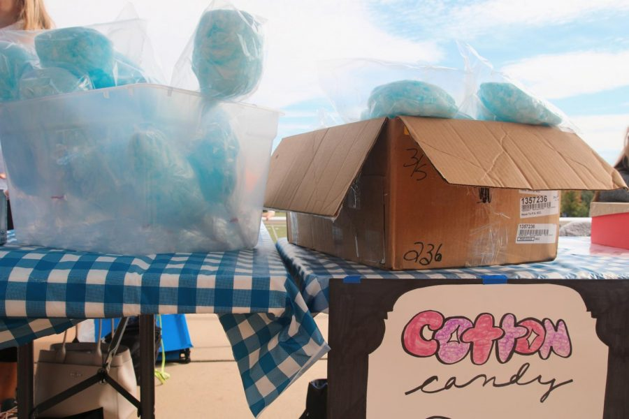 The 8th grade sold cotton candy at their booth to raise money for their class.