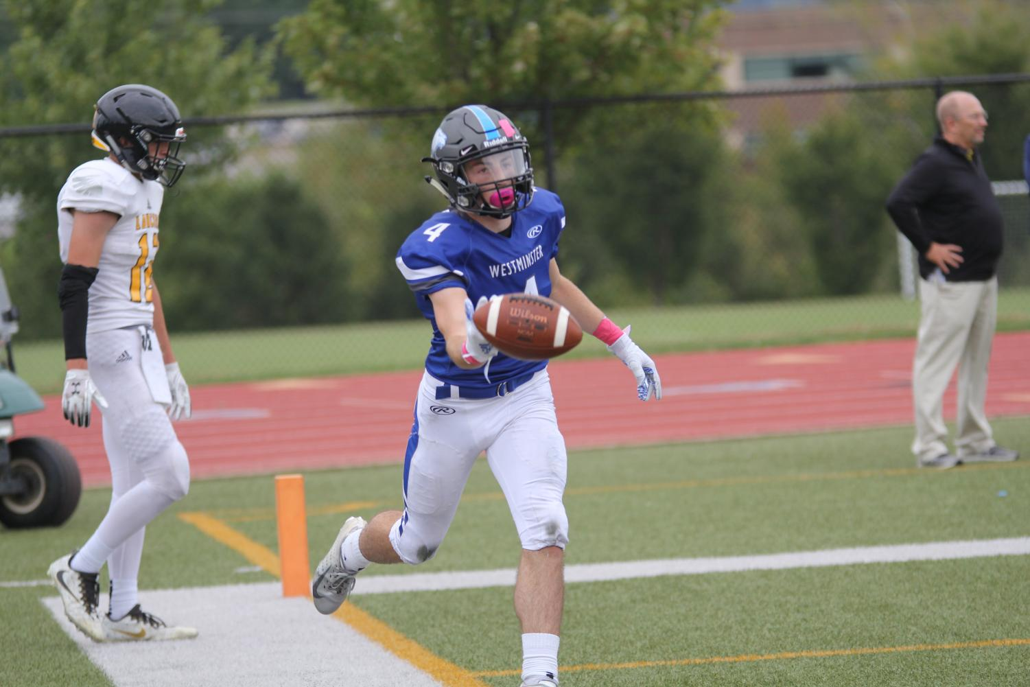 Ben Hicks tosses the ball to the referee after a long touchdown against Lutheran South.