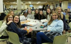 Ella Fiala and Katherine Kurop smile with their eighth grade PC group.