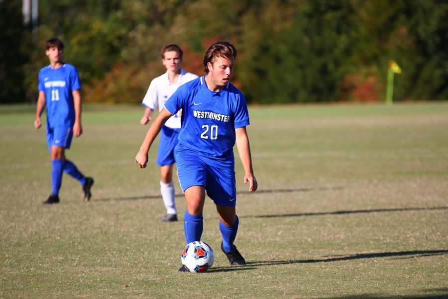 Senior Will Mason dribbles the ball down the field in a game against Duchesne on Senior Night.
