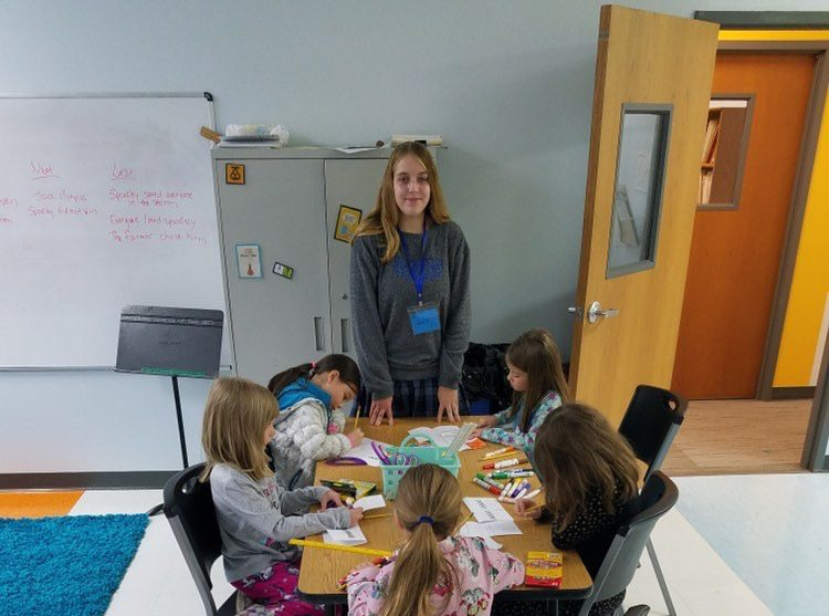 Senior Katherine Bauer with the students at Dayspring School of the Arts.
