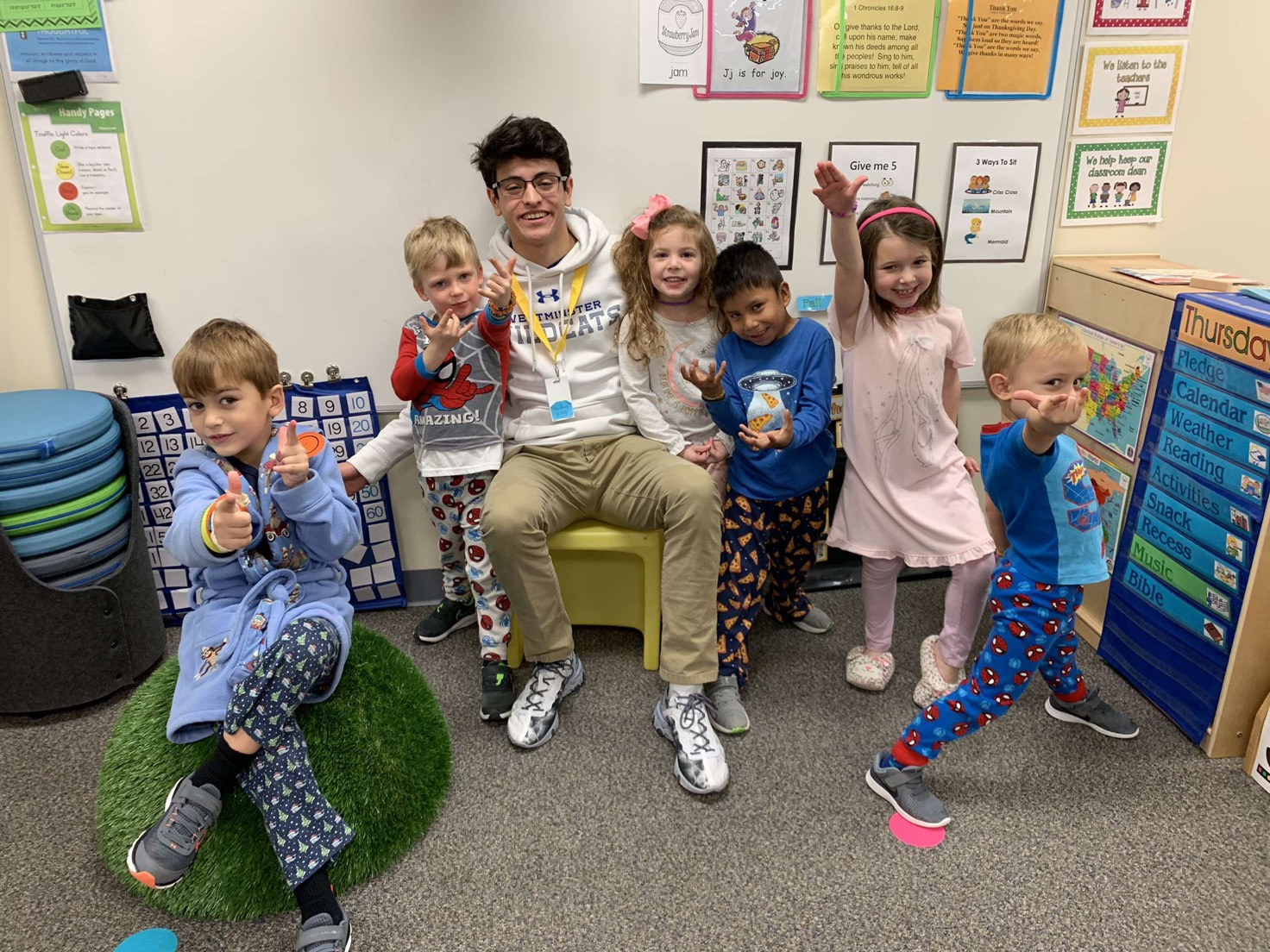 Senior Sebastian Lacassie serves a junior kindergarten class every Thursday morning at Kirk.