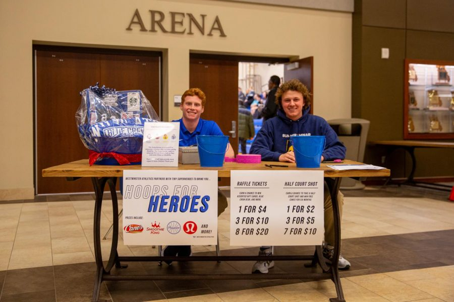 Jake+Broyles+and+I+sat+in+front+of+the+Arena+selling+tickets+to+our+raffles.