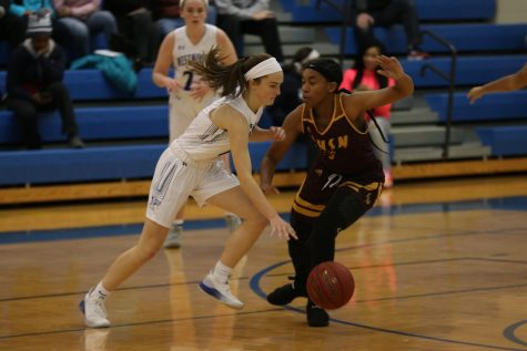 Girls Basketball Gets Exhilarating Win in Conference Opener on White Out Night