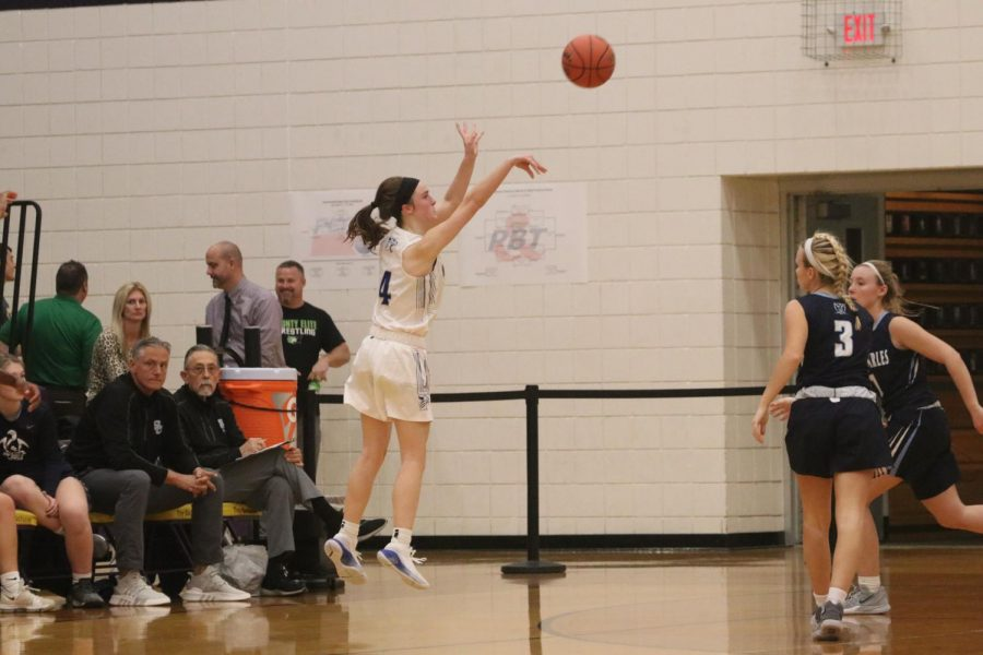 Brooke+Highmark+puts+up+a+three-pointer+in+a+game+against+St.+Charles+High+school.