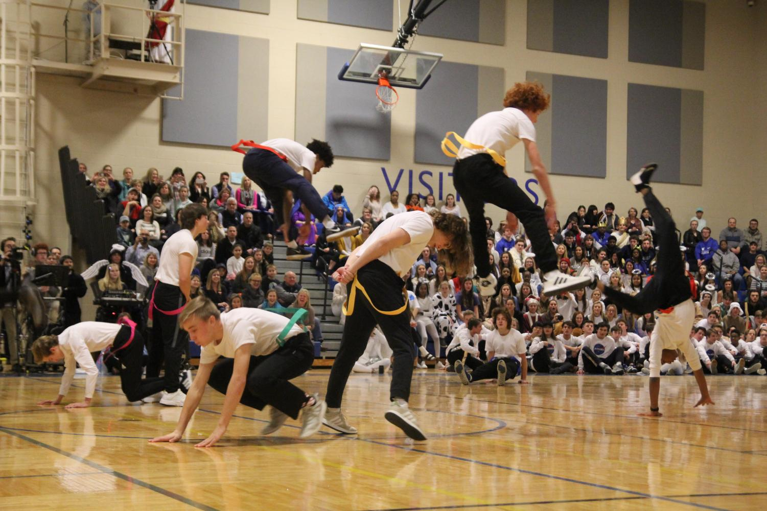The Class of 2021 performs boys poms during Spirit Week last year.