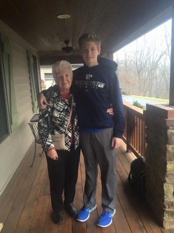 Brennan and Mrs. Beatty pose for a photo together outside his house.