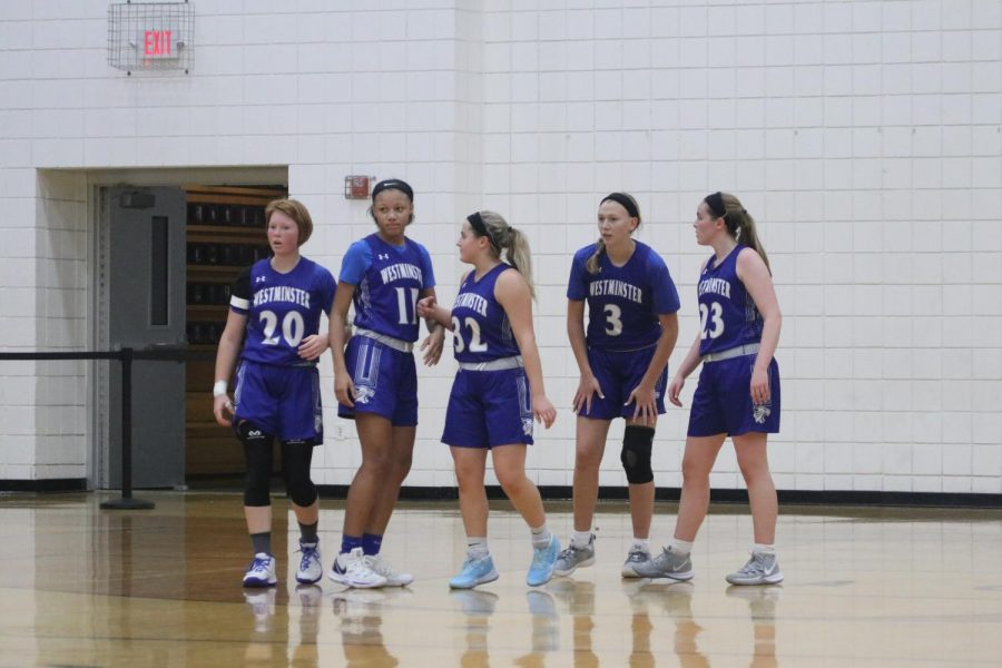 Girls basketball waits for play to resume during the Troy Tournament.