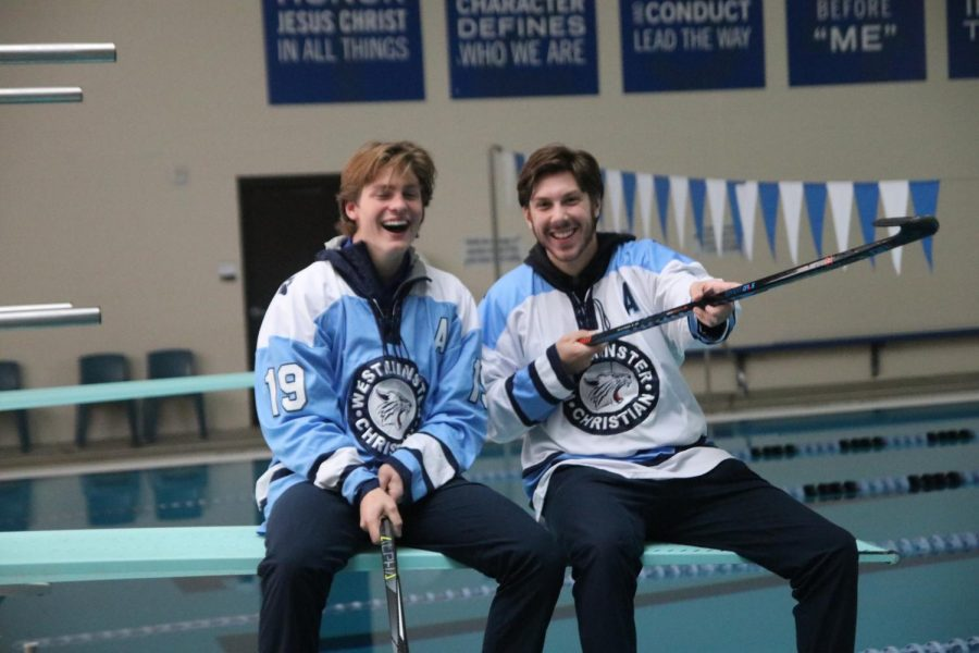 Assistant captains Jack Bystrom and Ben Parres pose for a photo on the diving board.