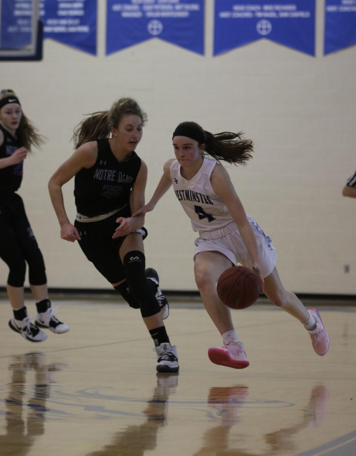 Sophomore Brooke Highmark pushes the ball down the floor against the press.