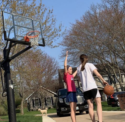 Brooke has passed the time playing basketball with her sister.