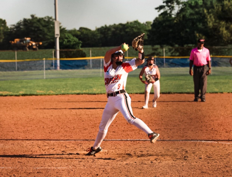 Merrifield pitches in a summer softball game for Crush.