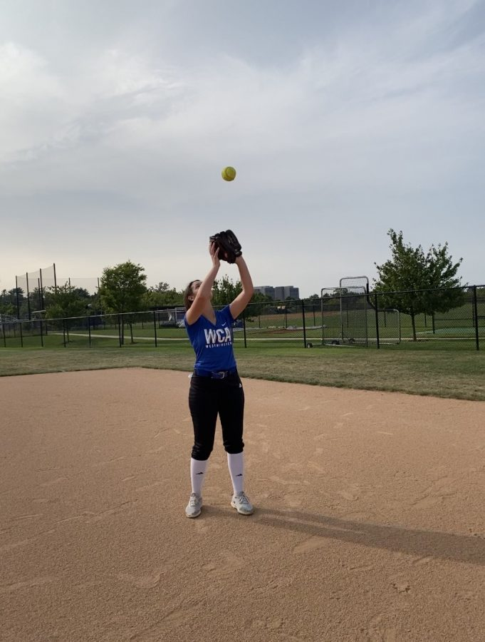 Nicki Mabry, Senior, catches fly ball at practice.