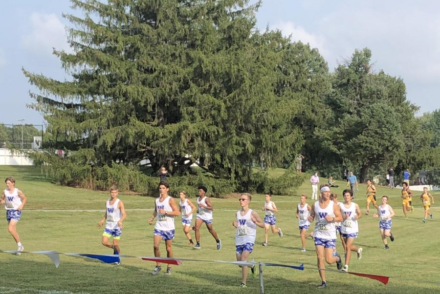 The Boys Cross Country Team warms up before the Eagle- Crusader Invitational.