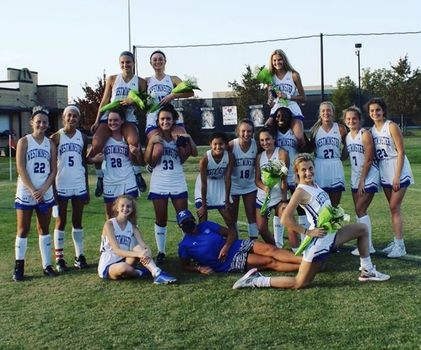 The+field+hockey+players+celebrate+Grace+Clement%2C+Ellie+Callier%2C+and+Abby+Sickels+on+senior+night.