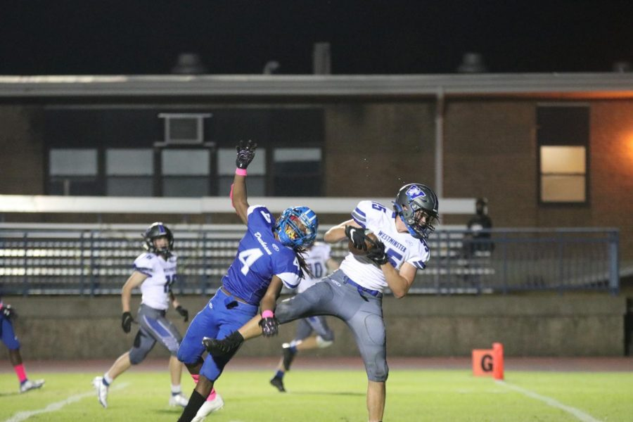 Brandon Parker, junior, catches a touchdown pass against Duchesne.