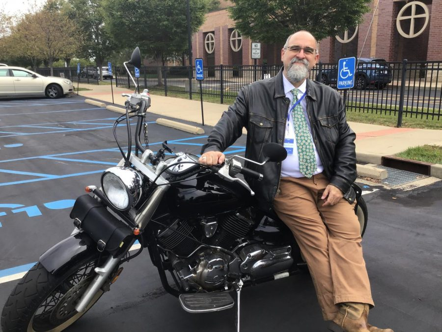 Mr.+Wolfe+enjoys+riding+his+motorcycle+to+school+on+sunny+days.+