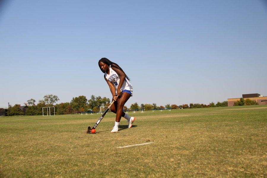 Mia+Scheulen+dribbles+the+ball+up+the+field.