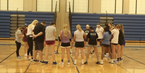 The JV and varsity teams circle in prayer at the start of practice.