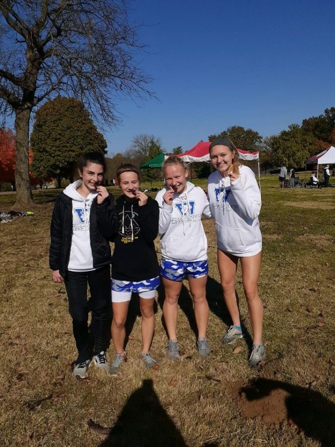Sabrina+Holohan%2C+Kate+Van+Zee%2C+Kharis+Perona.+and+Annessa+Shively+pose+with+their+All-District+medals.