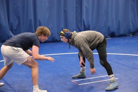 Brett. St. John and Kirk Briden, seniors, square off in practice.