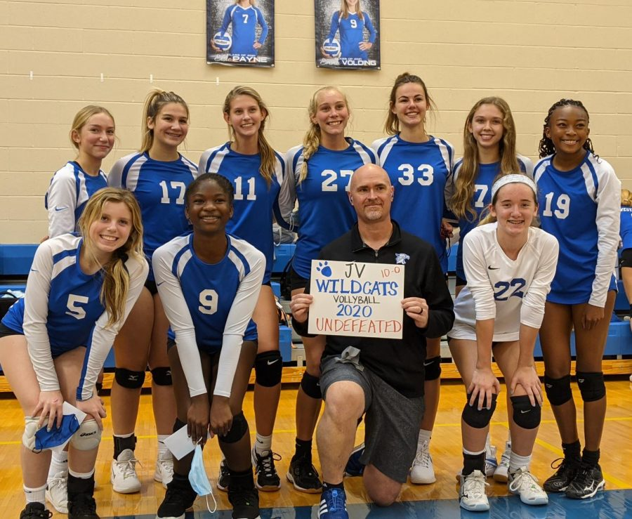 JV volleyball celebrates an undefeated season.
