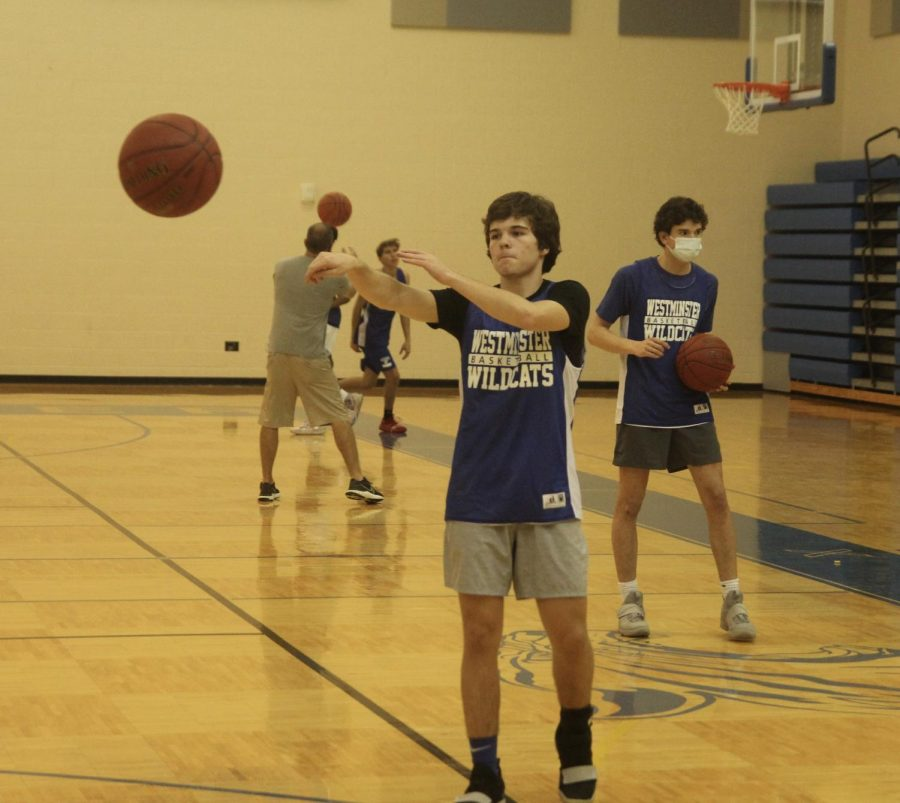Casen Lawrence, junior, passes the ball in a drill.