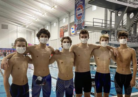 The boys swim team competes at state on November 15th.