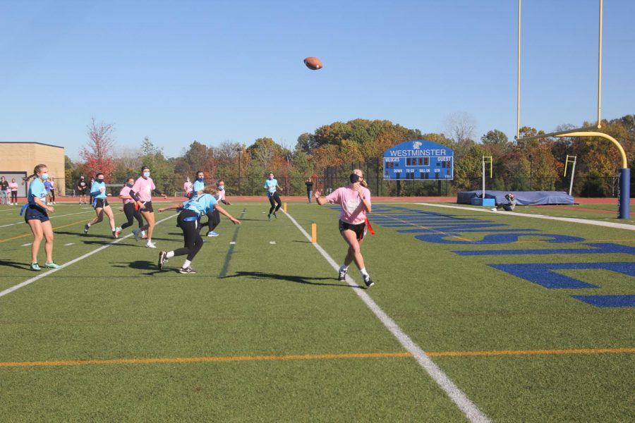 Carly Vick, junior, catches a long pass out of bounds.
