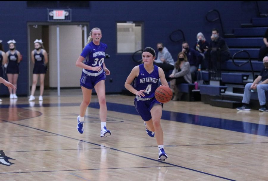 Carlie Vick trails Brooke Highmark on the way down the floor in a game against St. Dominic.