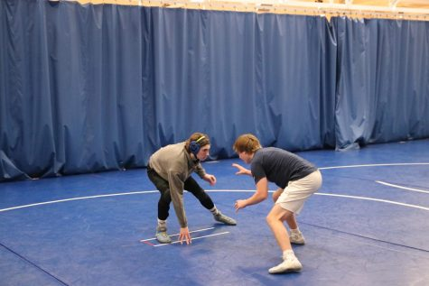 St. John (left) spars with fellow senior, Kirk Briden.