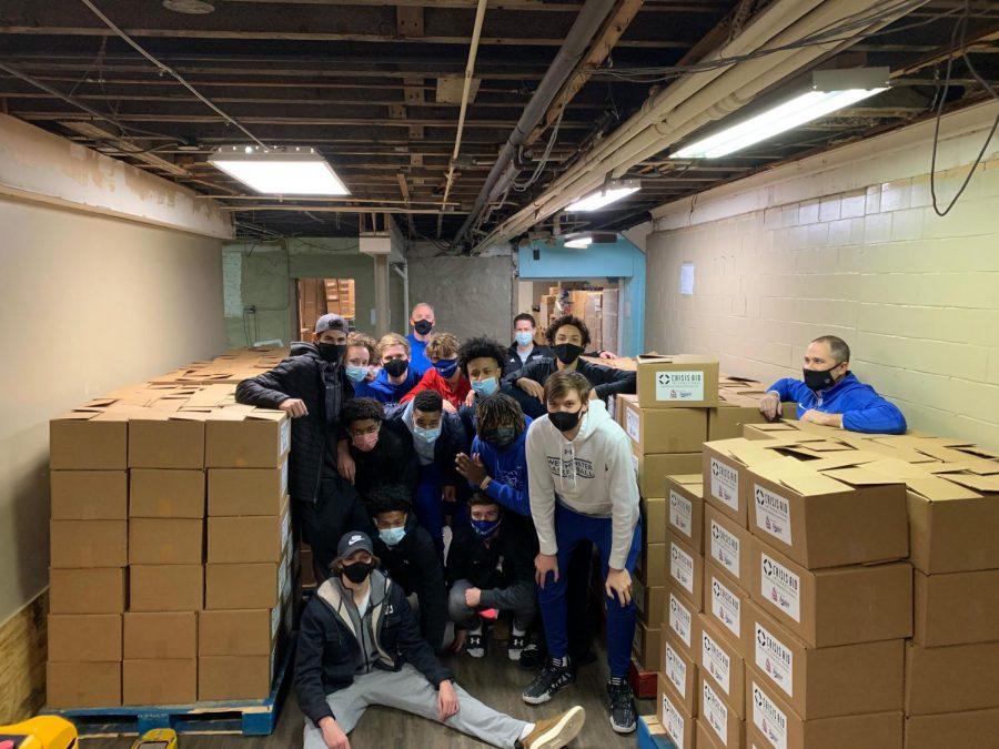 The boys varsity basketball team serves with Crisis Aid International.