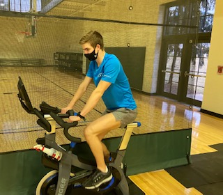 Caleb Moellenhoff cross trains as he works hard to stay in shape while recovering from injury.