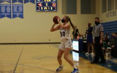 Carlie Vick shoots a three pointer against Cor Jesu.