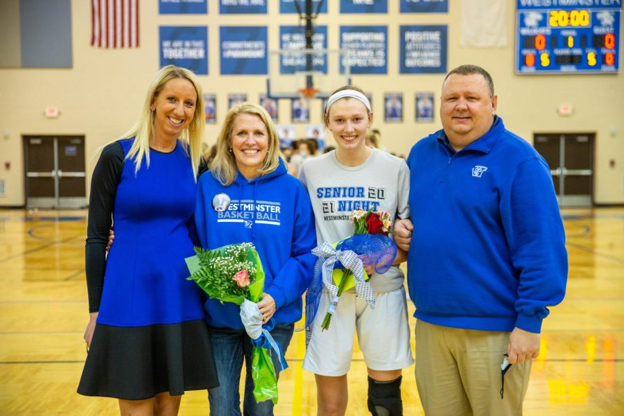 Marty Briner stands with her mother, Jennifer, father, Shawn, and coach, Kat Martin.