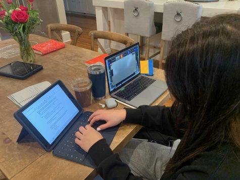 Reilly Brophy participates in online school.