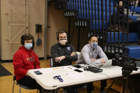Tyler Collison helps announce the Westminster vs. Priory boys basketball game.