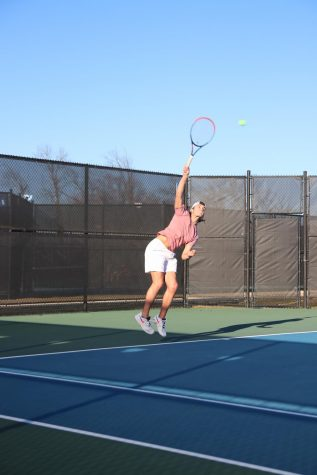 Daniel Stengel, junior, serves an ace during tryouts.