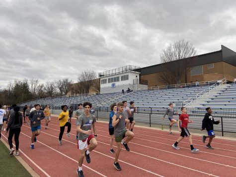 The track team warms up before a hard workout.
