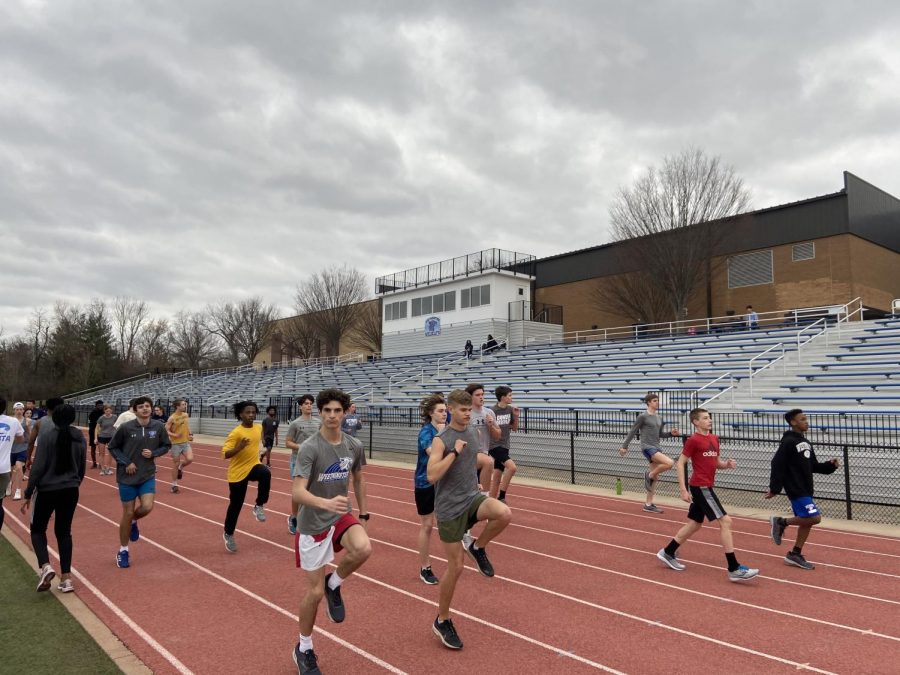 The+track+team+warms+up+before+a+hard+workout.