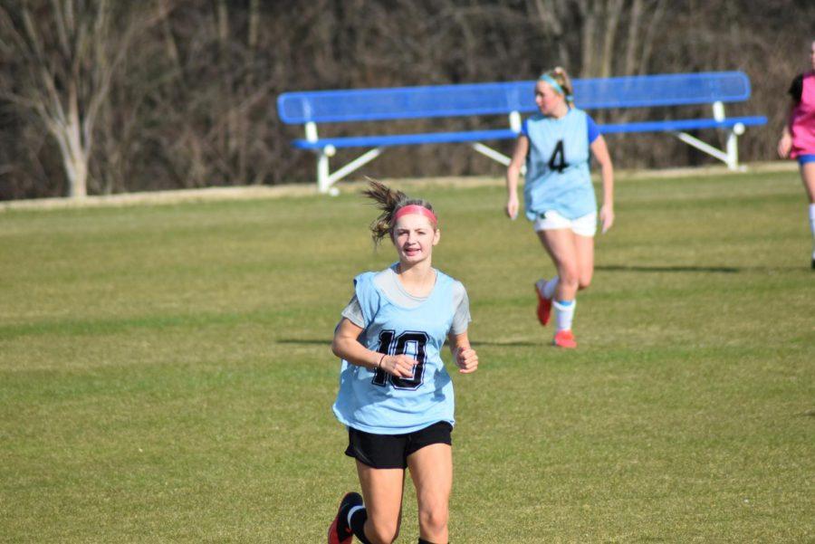 Lauren Sowers, sophomore, jogs during pratice.