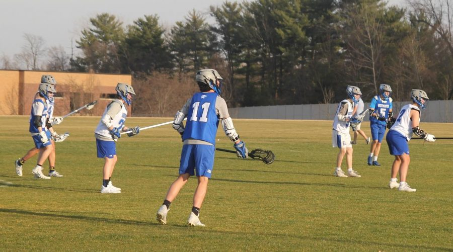 The boys lacrosse team scrimmages during a pratice.