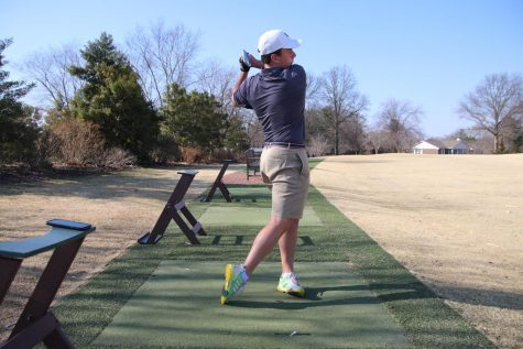 Jack Wooldridge hits balls at the range.