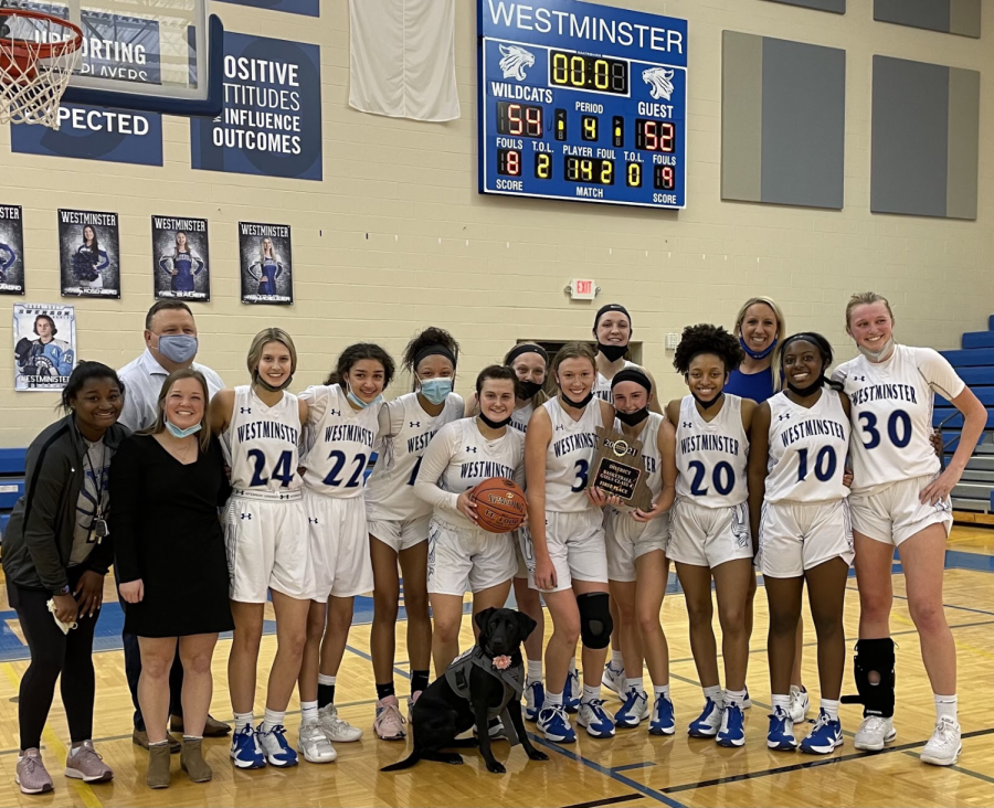 The girls basketball team beat John Burroughs 54 to 52 in the District championship.