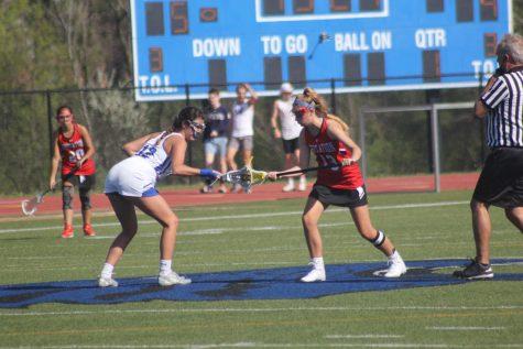 Kara Galakatos, senior, takes a draw at center field.