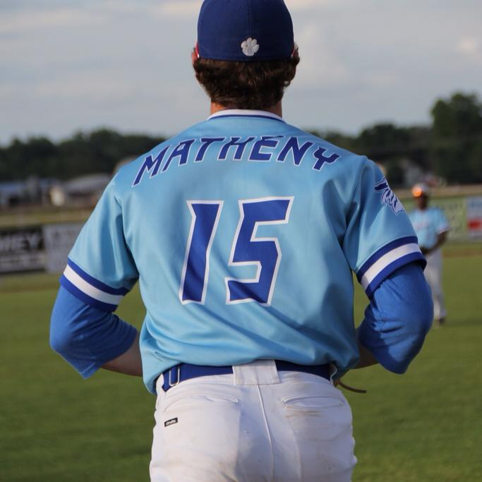 In his senior year of highschool, Matheny runs out to the field before the start of the game.