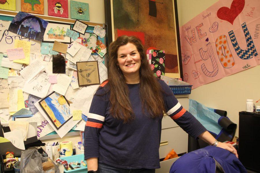 Mrs. Vogel standing in her classroom