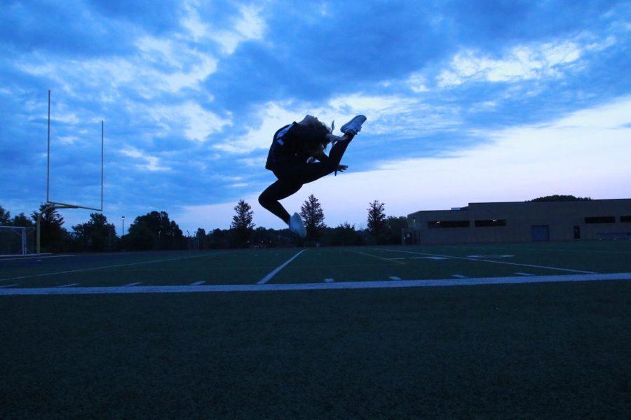 Sarah Sadler, junior, leaps for an action shot.